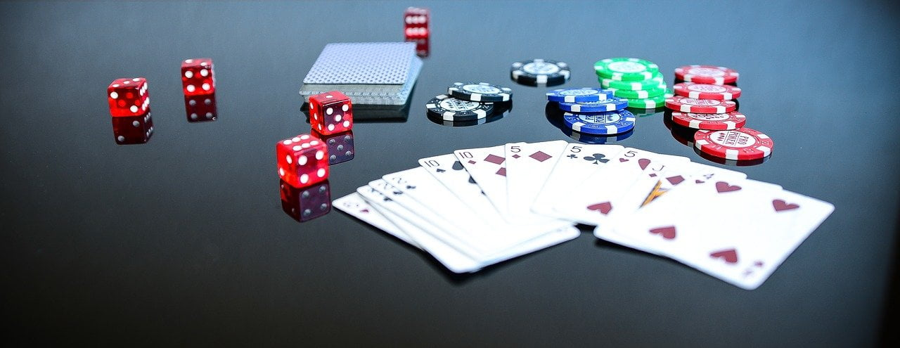 """alt=""""poker game with cards and dices on a beautiful table"""""""